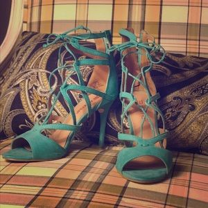 Strappy teal pumps